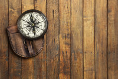 Old compass on wooden background with space for text Royalty Free Stock Photo