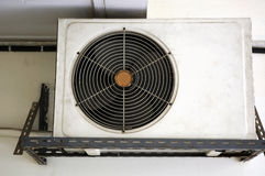 Old compressor air condition. Old hanging unit of compressor air condition Stock Photo