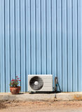 Old compressor air-conditioner and Flower Pot on zinc wall Royalty Free Stock Images