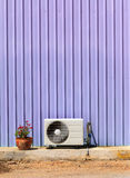 Old compressor air-conditioner and Flower Pot on zinc wall Stock Photography