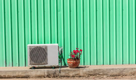 Old compressor air-conditioner and Flower Poten royalty free stock photos
