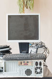Old computer and accessories for electronic recycling. Dirty old computer, keyboard, dusty monitor for electronic recycling royalty free stock images