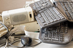 Old computer accessories for electronic recycling. Dirty old keyboard, mouse, speakers for electronic recycling stock photography
