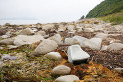 Old computer monitor lying on the beach. Stock Images
