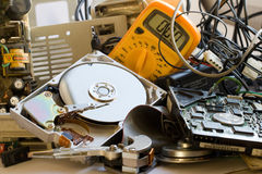 Old computer parts. Pile of Old computer parts and hard disks Stock Photo