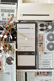 Old computers and computer accessories for electronic recycling. Dirty old computers, cd-rom, printer for electronic recycling royalty free stock photos