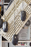 Old computers and computer accessories for electronic recycling. Dirty old computers, keyboard, mouse for electronic recycling stock image