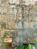 Old concrete block wall. With empty hanging flower pots Stock Images