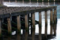 Old Concrete Coastal Jetty Moorings Structure stock image