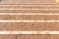 Old concrete down stairs with the tile border. Decoration of stairs royalty free stock photos
