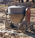Old concrete mixer. Old grunge concrete mixer at the construction site Royalty Free Stock Images