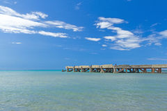 Old concrete pier on the calm sea Royalty Free Stock Image