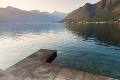 Old concrete pier in Perast town. Kotor Bay Stock Photography