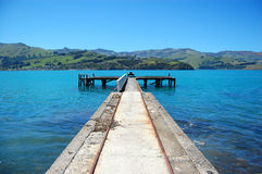 Old concrete pier with rails Stock Images