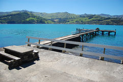 Old concrete pier with rails and table Stock Image