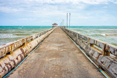 Old concrete pier at Thung Wua Laen beach Royalty Free Stock Image