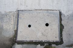 Old concrete pipe cap plate on road. Concrete pipe cap plates. Drainage cover. Sewer drain on the pavement stock image