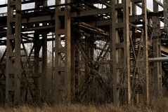 Old concrete pipeline supports in dry winter vegetation stock image