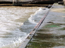 Old concrete river bank of CHAO PHRAYA river in BANGKOK, THAILAND Stock Image