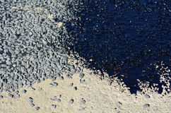 Old concrete road surface with fresh tar and new asphalt road Stock Image