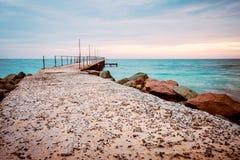 An old concrete sea bridge with rusty rails at the Black sea coast in Ravda, Bulgaria.  royalty free stock image
