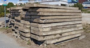 Old concrete slabs dug out of the ground and stacked. Construction site of the new stadium royalty free stock photo