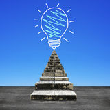 Old concrete stairs toward light bulb. Hand drawing, with blue sky background Stock Photos