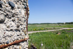 Old concrete structures. In the green grass Royalty Free Stock Image