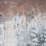 Old concrete wall as abstract background. Outdoor photo of old painted concrete wall as abstract grunge texture background Stock Photo