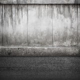 Old concrete wall and asphalt Stock Photography