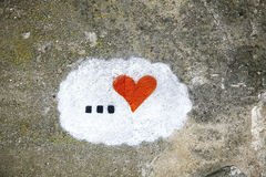 Old concrete wall background with hand painted heart Stock Photos