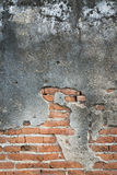 Old concrete wall with bricks background Stock Photography
