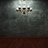 Old concrete wall and chandelier Stock Images