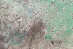 Old concrete wall in cracks. background texture. Old concrete wall in cracks and holes. Background texture. With traces of green paint Stock Photos