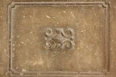 Old Concrete Wall Fragment With Handmade Frame And Bas-Relief Sh Stock Image