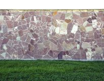 Old concrete wall pale and cracked and have green grass at the b stock photography
