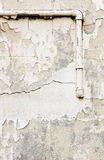 Old Concrete Wall and Pipes Background. Old pipes and concrete wall with peeling paint as background texture royalty free stock images
