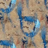 Old concrete wall with streaks of blue paint Stock Image