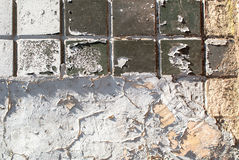 Old concrete wall which is partly covered with ceramic tiles texture background Stock Images