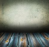 Old concrete wall and wooden floor interior Royalty Free Stock Image