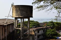 Old concrete water tower in India. Old concrete water tower on a coastline. Colonial architecture near ancient fort. Thalassery, Kerala, India stock photo