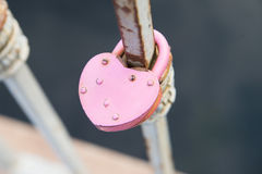 Old condition rusty metal lock. Shape heart Royalty Free Stock Photo