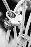 Old condition rusty metal lock. Shape heart Stock Photography