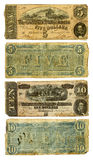 Old Confederate Five and Ten Dollar Bills. The front and back of two dirty and very worn five and ten dollar bills from the United States. Printed by the Royalty Free Stock Images