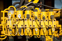 Old connectors. A unit with yellow plastic power connectors with wires and hoses stock photos