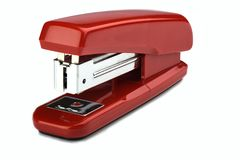 Old constantly used red stapler isolated on white background. Copy space. close up royalty free stock photo