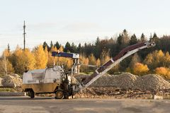 Old construction road machinery, pavement milling or cold planing. Asphalt milling, or profiling Royalty Free Stock Image