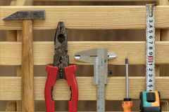 Old Construction tools on wooden slats close-up royalty free stock images