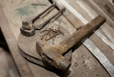 Old construction tools. Old rusty vintage construction tools on workshop table royalty free stock photo
