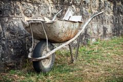 Old construction wheelbarrow Royalty Free Stock Photo